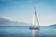 canvas print picture - Sailing yacht in the sea against the backdrop of mountains