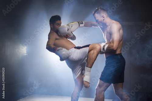 Two boxers athletes training in the gym Canvas-taulu