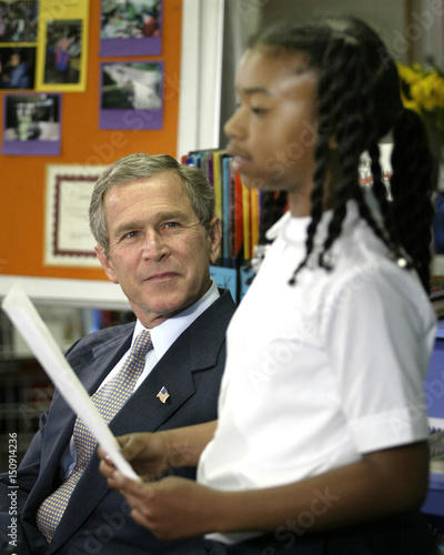 Us President Bush Listens To A Student Read At Michigan