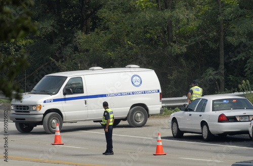 Lexington-Fayette County coroner vans leave crash site of