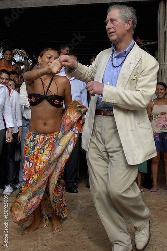Britain's Prince Charles dances carimbo, a typical dance of