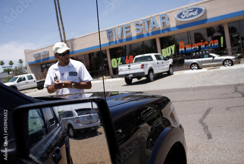 A Ford Edge Is Reflected In Mirror As Lot Attendant Charlie Long Looks Over Vehicles