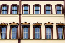 Ornate Windows On Yellow Plaster Building