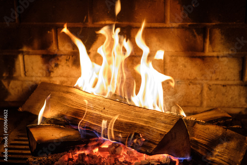 Fotomural fire burns in the fireplace