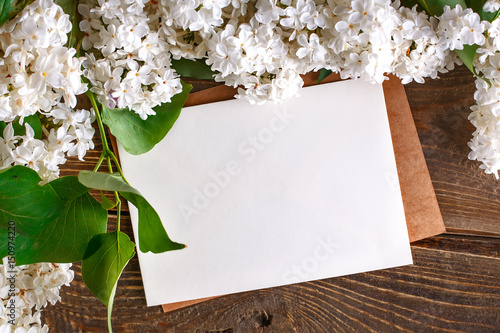 Wall Murals Lily of the valley Branches of lilac lying on wooden boards with postcards.