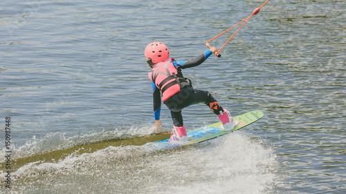 a little girl to ride a Wakeboard. Photo of grain processing