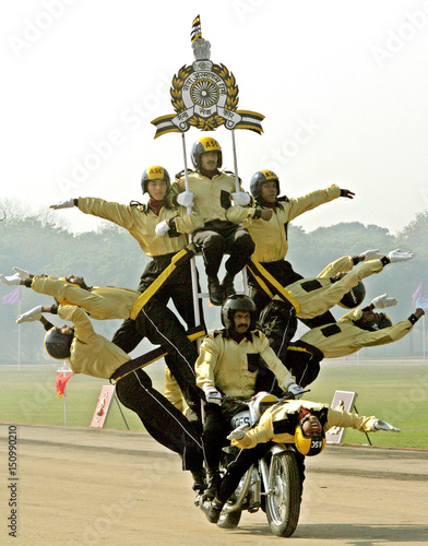 Indian soldiers perform a dare devil show during their Army