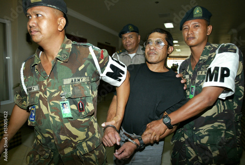 12ecfec668c Philippine army soldiers escort suspected communist leader Eduardo Serrano  after a news conference a.