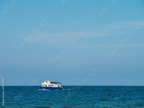 Foto op Canvas Schipbreuk Running boat on the sea