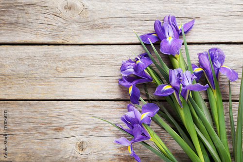 Foto op Plexiglas Iris Bouquet of iris flowers on grey wooden table