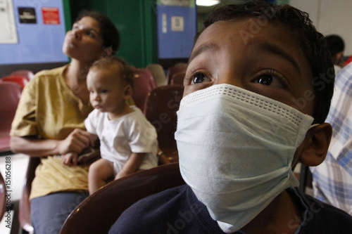 Influenza Wears H1n1 Surgical Against A Boy Mask Precaution As