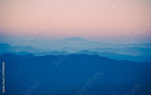 Spoed Foto op Canvas Groen blauw Beautiful sunset in mountain and fog landscape.