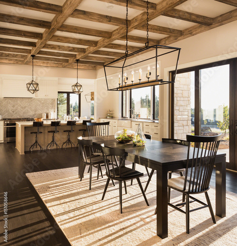 Beautiful Dining Room And Kitchen In New Luxury Home At Sunrise Features Cross Hatch Beams