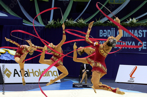 Members of Russian team perform during the group apparatus