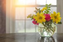 Spring Flowers On Table In Vas...