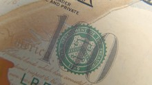 Stamp Of The Treasury On A Hundred-dollar Bank Note Close-up. Rotation