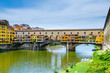 Ponte Vecchio, Old Bridge, medieval stone arch bridge over the Arno River and with many small shops along it, Florence, Tuscany, Italy, Europe. UNESCO World Heritage Site