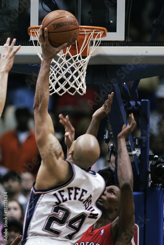 New Jersey Nets  Richard Jefferson lays up the game winning basket against  the Toronto Raptors  Chris Bosh after Game 6 of their NBA Eastern  Conference ... 5652862a4