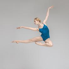 Ballerina Posing In Jump