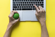 canvas print picture - Office worker typing email on computer, feels stressed and nervous, holds a stress ball in her hand