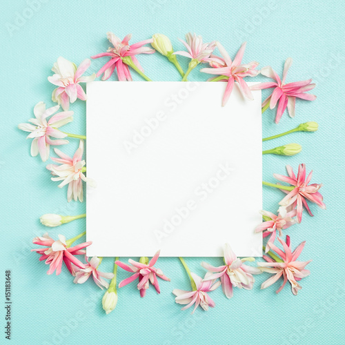 Bunch Of Little Lovely Flower On White Empty Paper Card Over Blue