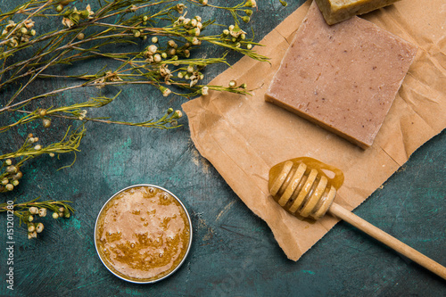 Fotografie, Obraz  Close-up view of handmade soap, honey, dried flowers and cream for beauty care