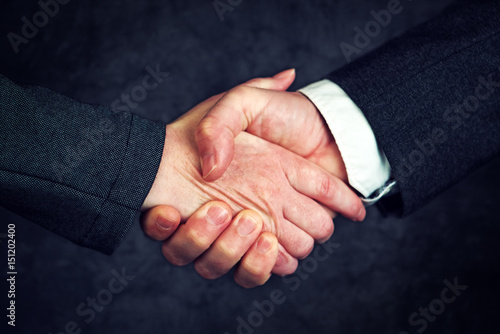 Joint Enterprise Handshake Over Business Agreement Buy This Stock