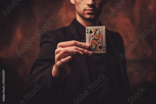 Cuadros en Lienzo Man showing tricks with cards
