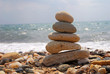 Stack of stones on the rocky beach. Concept of balance and harmony at the sea