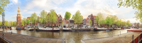 Spoed Foto op Canvas Amsterdam Canals of Amsterdam. Sunny panorama of old town district