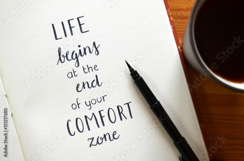 Fotografie, Obraz  LIFE BEGINS AT THE END OF YOUR COMFORT ZONE written in brush calligraphy on note