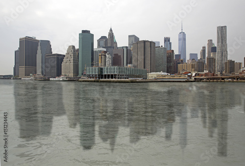Skyline of Manhattan with reflection on the water, New York USA