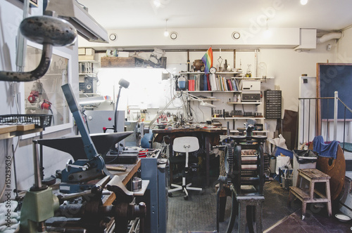 Old machinery and various work tools in jewelry workshop
