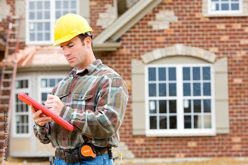 Fotografía  Construction: Home Inspector Checking House