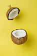 canvas print picture Coconut on yellow colored background, minimal flat lay style