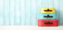 Travel Concept With Retro Style Suitcases On Blue Wooden Background