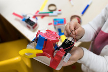 Construction Of Children's Robots. Colored Boxes With Paper Strips, Inventions And Creativity For Children. Trash Robots, Tinkering And Making, Educational Activities For Schools And Children