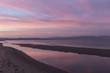 Rosada puesta de sol en la playa del Fangar del Delta del Ebro