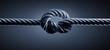Knoten im Seil vor dunklem Hintergrund