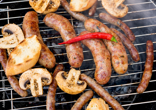 In de dag Grill / Barbecue sausages grilled with vegetables