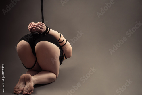 Foto op Aluminium Ezel beautiful ass female slave with tied hands