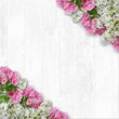 Vintage white wooden background with branches of spring flowers