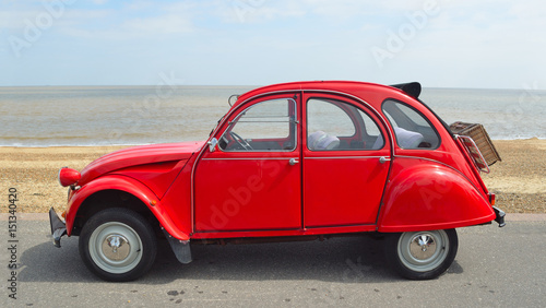 Photo  Classic Red Citroen 2CV  deux chevaux parked on seafront promenade