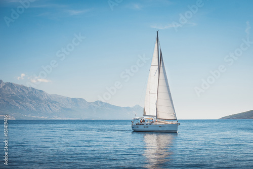 Slika na platnu Sailing yacht in the sea against the backdrop of mountains