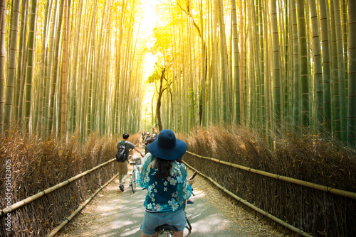 Poster Kyoto Tourist is cycling for sightseeing at Arashiyama bamboo forest in Kyoto, Japan.