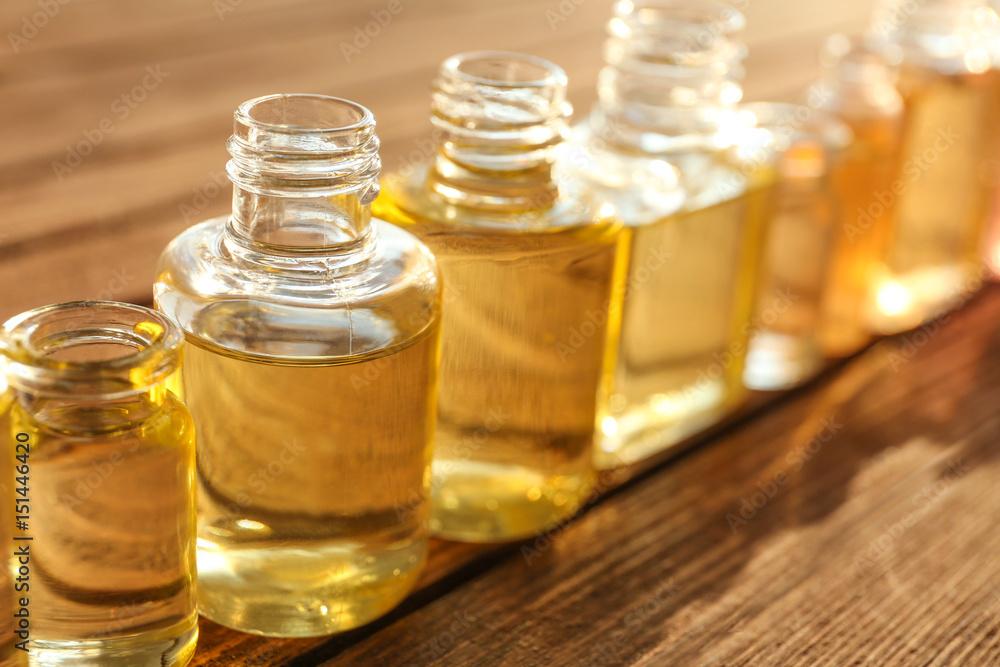 Fototapety, obrazy: Perfume bottles on wooden table