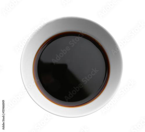 Bowl with tasty soy sauce on white background Fototapet