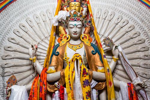 Fotografia  The Avalokitesvara, a Tibetan Buddhist saint with a thousand hands at Lamayuru Monastery in the Indian Himalaya