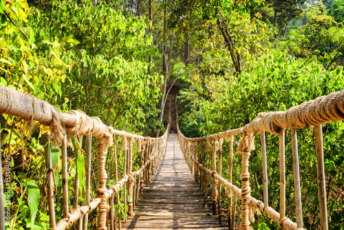 Photo sur Toile Bambou Beautiful footbridge made from rope and bamboo