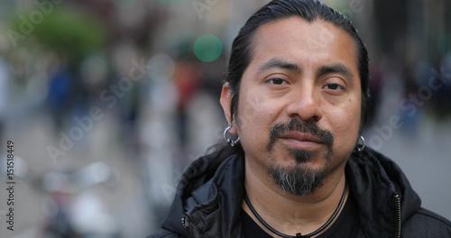 Hispanic Latino man in city face portrait Wallpaper Mural